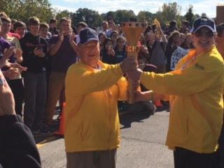 Indiana Bicentennial Torch is passed to Coach Wright for a Hamilton County leg of the relay